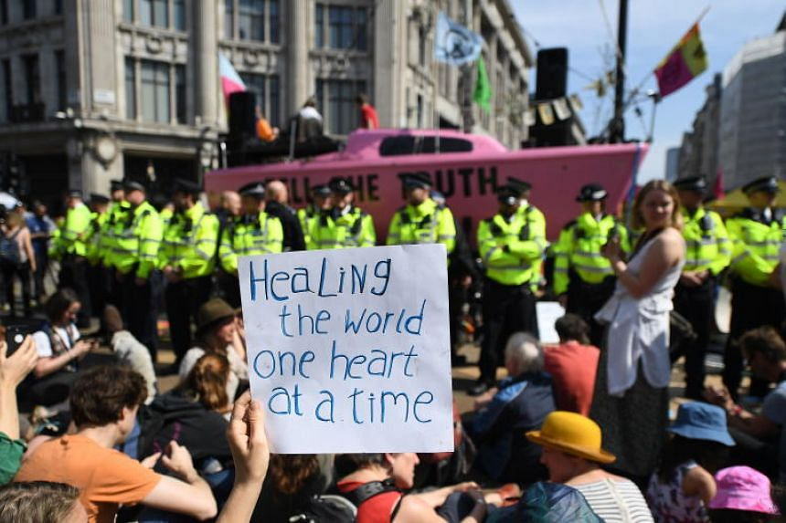 Extinction Rebellion climate change protestors during a demonstration at Oxfords Circus in London, Britain, on April 19, 2019.