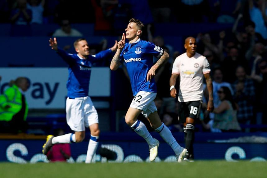 Everton's Lucas Digne (centre) celebrating after scoring his side's third goal against Manchester United during their EPL match on April 21, 2019.