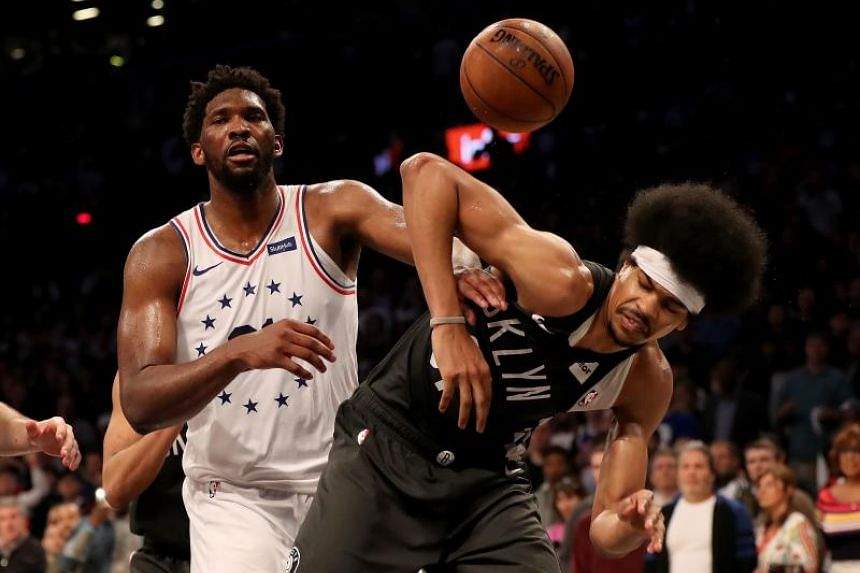 Philadelphia 76ers centre Joel Embiid (left) fighting for position with Brooklyn Nets centre Jarett Allen during their NBA playoff match on April 20, 2019.