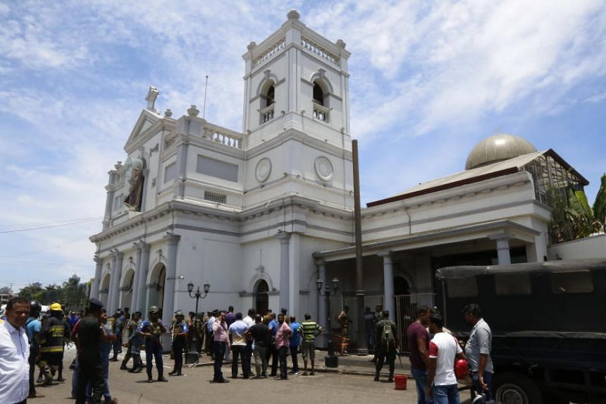 Security officers gathering at the scene of an explosion at St Anthony's Church in Kochchikade in Colombo, on April 21, 2019.
