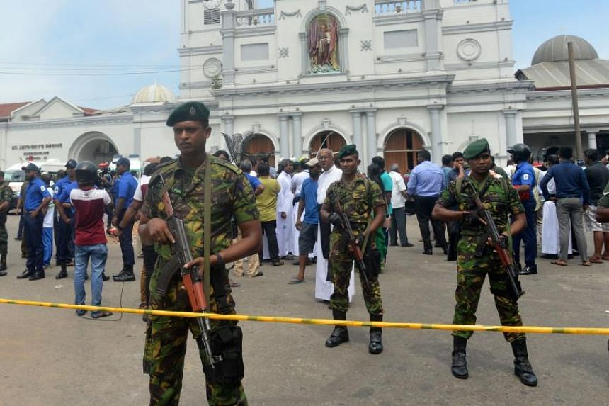 Sri Lankan security personnel standing guard outside St Anthony's Church in Kochchikade, after it was hit by an explosion, on April 21, 2019.