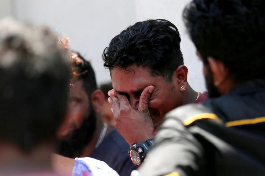 A relative of a victim of the explosion at St Anthony's Church crying at the police mortuary in Colombo, on April 21, 2019.