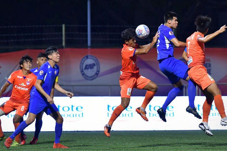 Albirex's defender Shoki Ohara heading the ball clear in the Singapore Premier League match against the Young Lions at Jurong East Stadium on April 21, 2019.