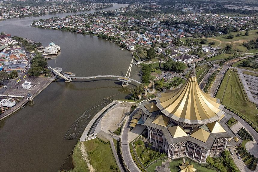 The gold umbrella roof of the New Sarawak State Legislative Assembly Building is an iconic landmark in Kuching and located on the north bank of the Sarawak River. PHOTO: BERNAMA Sunset at the waterfront in Kota Kinabalu, Sabah. While the debate over