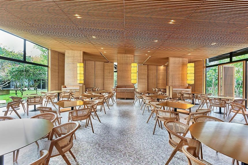 Min Jiang at Dempsey seats 158 diners in a space that incorporates wood and rattan in its timbre trellis ceiling and panelled walls.
