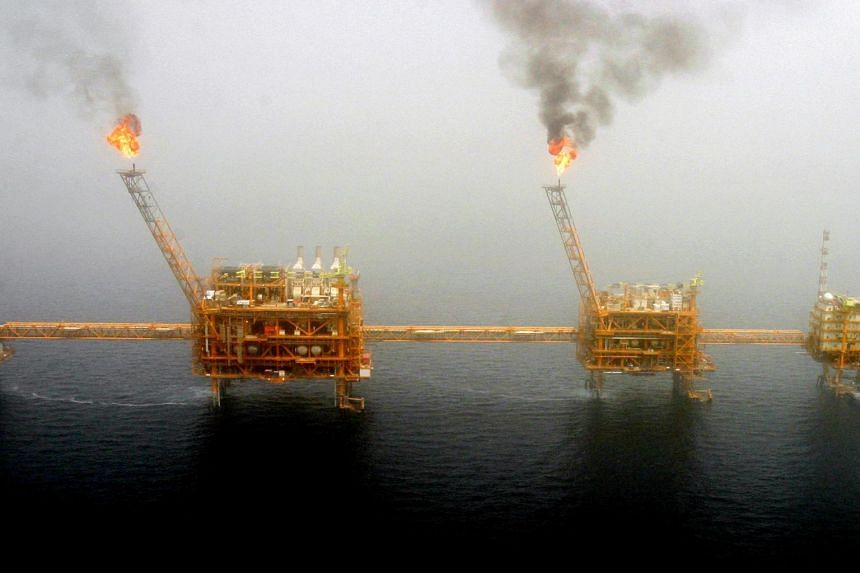 Gas flares from an oil production platform at the Soroush oil fields in the Persian Gulf, south of the capital Teheran, on July 25, 2005.