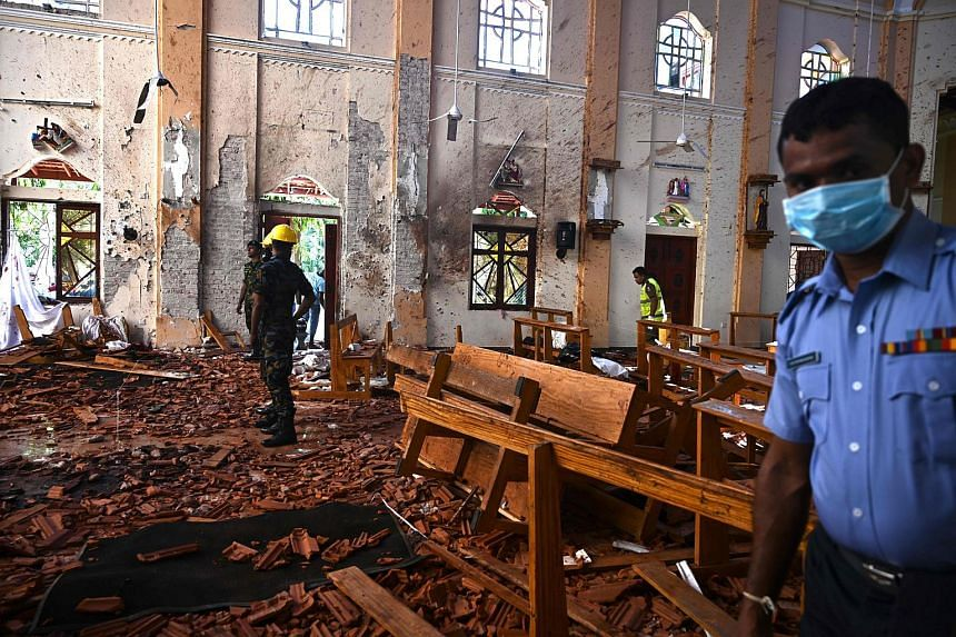 Security personnel inspecting the interior of St Sebastian's Church in Negombo, Sri Lanka, on April 22, 2019, following the Easter Day attacks.