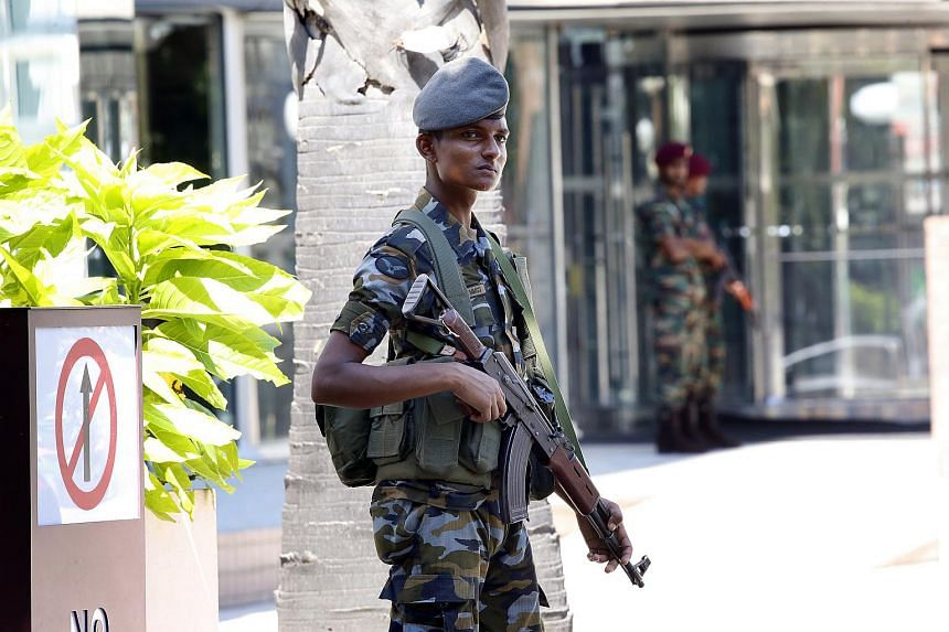 Sri Lankan security personnel stand guard outside the World Trade Centre after multiple fatal explosions occurred the day before, in Colombo, Sri Lanka, on April 22, 2019.
