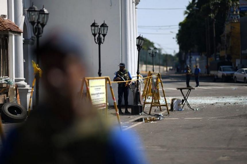 Security personnel stand guard outside St. Anthony's Shrine in Colombo on April 22, 2019, a day after the church was hit in series of bomb blasts targeting churches and luxury hotels in Sri Lanka.