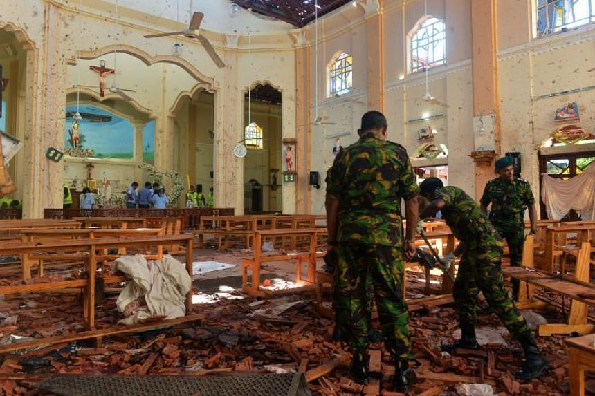 Security personnel in St. Sebastian's Church in Negombo, Sri Lanka, on April 22, 2019, a day after the church was hit in series of bomb blasts targeting churches and luxury hotels in the country.