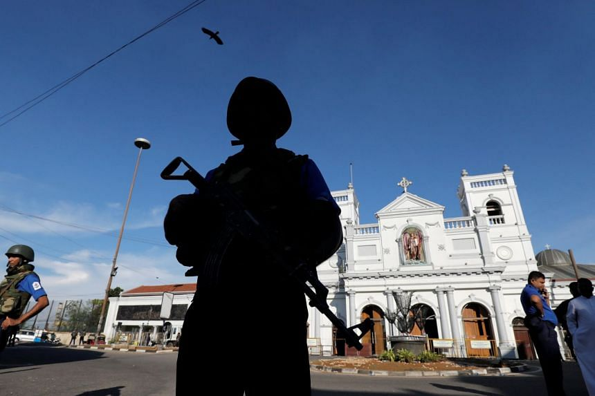 A security officer stands guard in front of St Anthony's Shrine in Colombo following the Easter Day attacks in Sri Lanka, on April 22, 2019.