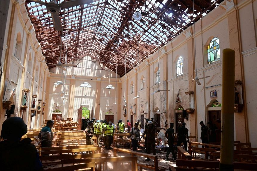 Officials inspecting the damage at St Sebastian's church in Negombo, following the Easter Sunday attacks in Sri Lanka, on April 21, 2019.