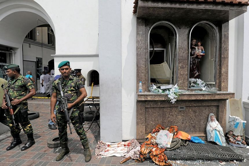 Sri Lankan military officials stand guard in front of St Anthony's Shrine following an explosion in Colombo, Sri Lanka, on April 21, 2019.
