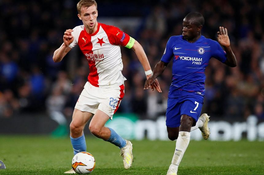 Slavia Prague's Tomas Soucek in action with Chelsea's N'Golo Kante.
