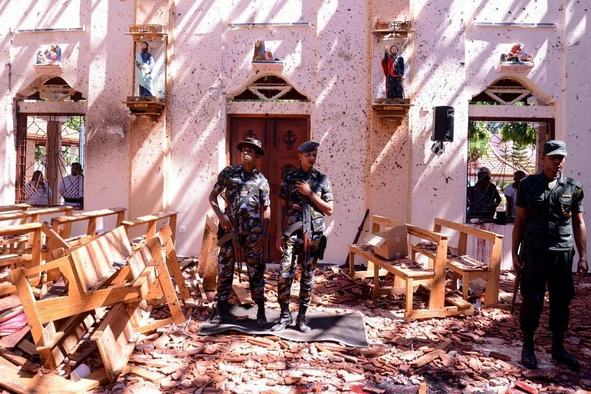 Sri Lankan soldiers inside St Sebastian's Church at Katuwapitiya in Negombo on April 21, 2019, following a bomb blast during the Easter service.