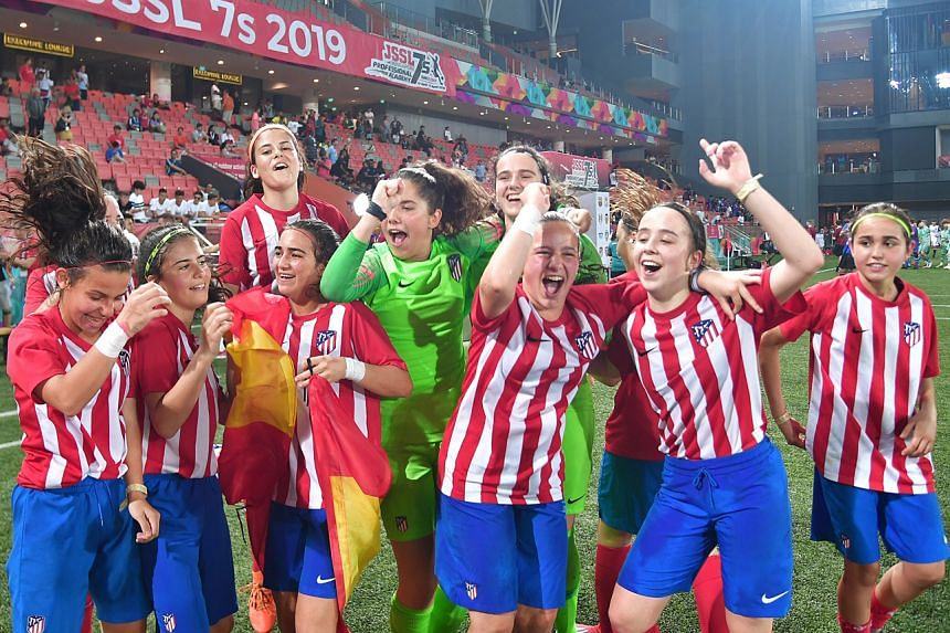 The girls' team from Atletico Madrid celebrating after being crowned the inaugural JSSL Professional Academy 7s girls' champions yesterday.