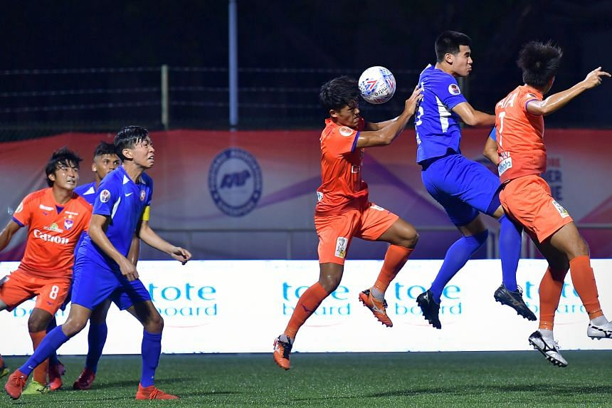 Albirex defender Shoki Ohara heading the ball clear in his team's Singapore Premier League match against the Young Lions. After a slow start, the three-time defending champions have won three straight games.