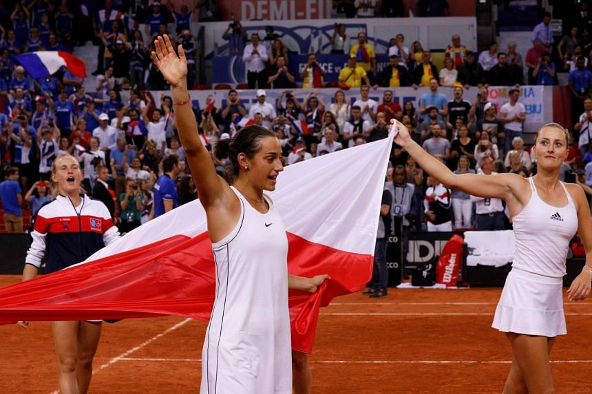 Kristina Mladenovic (right) and Caroline Garcia celebrating after winning the doubles in France's 3-2 Fed Cup tennis semi-final victory over Romania at The Kindarena in Rouen on April 21, 2019. The team play Australia in the November final.
