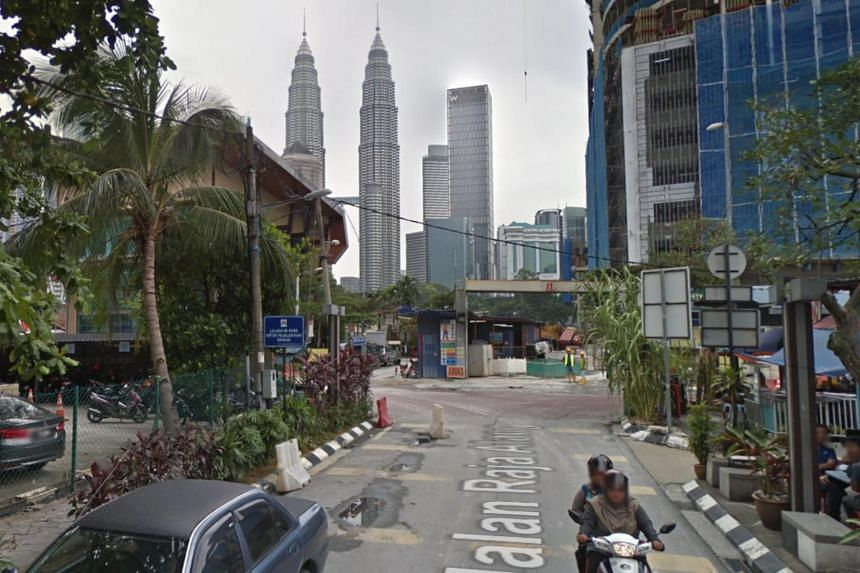 The area, consisting of many low-rise brick and wooden homes, old flats and shophouses, sits just 500m from the Twin Towers.