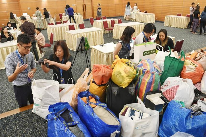 Straits Times travel writer Lee Siew Hua (second from left) donated about 5kg in textiles at SPH's Earth Day 2019 event on April 22, 2019.