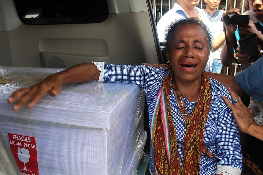 Ms Petronela Koa in tears on Feb 17 last year when the coffin containing her niece Adelina Sau arrived in East Nusa Tenggara. Ms Sau was found outside her employer's home covered with wounds. She died in hospital.