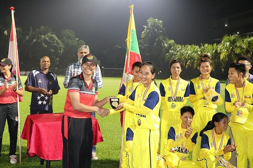 National women's cricket captain Shafina Mahesh with her Myanmar counterpart Zar Lin Win at the end of the ICC T20 International Cricket Series between their teams. The event took place at the Singapore Cricket Club from April 18 to 20. Myanmar won t
