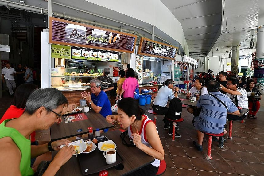 Mixed-use development DUO won the Gold Award. Seven public-sector projects, including Ang Mo Kio Polyclinic (right) and Pasir Ris Central Hawker Centre (below), won the Gold Plus Award.