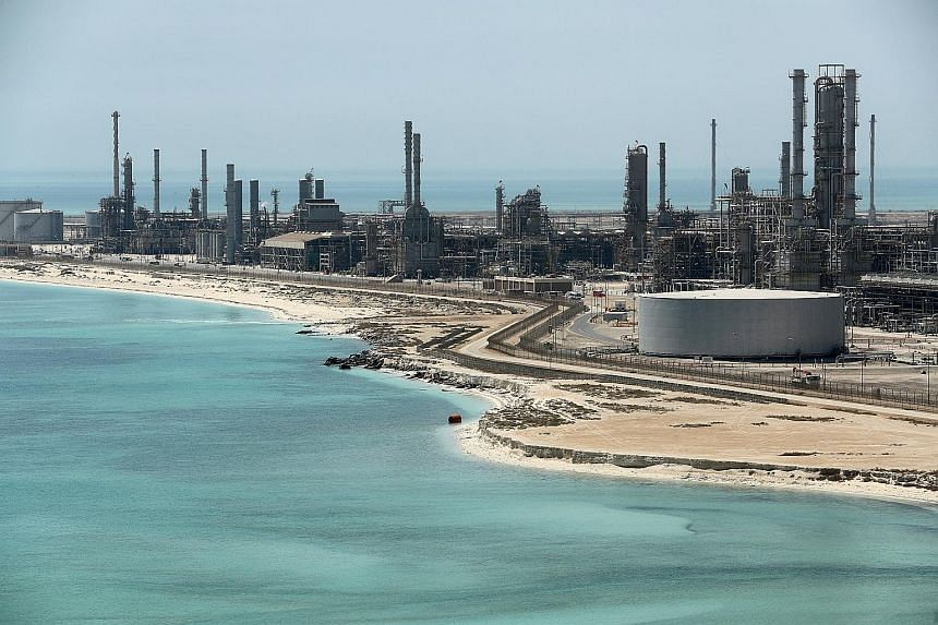 Saudi Aramco's Ras Tanura oil refinery in Saudi Arabia. Oil has rallied almost 40 per cent this year as the Organisation of Petroleum Exporting Countries and its allies continued their commitment to curb output in a bid to avert a glut. Yesterday, an