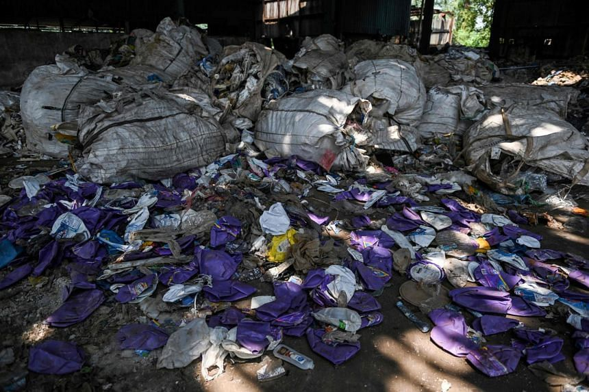 Plastic waste at an abandoned factory in Jenjarom, a district of Kuala Langat, outside Kuala Lumpur. Malaysia's Environment Minister Yeo Bee Yin said plastic waste is being smuggled in from developed countries such as the United Kingdom, Australia, U
