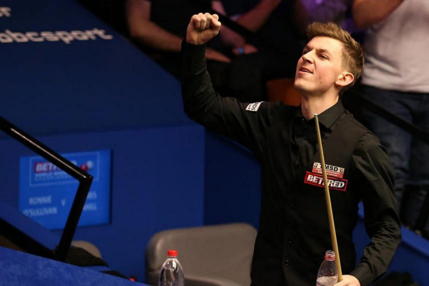 James Cahill (above) beat Ronnie O'Sullivan 10-8 to advance to the second round of the World Snooker Championship.