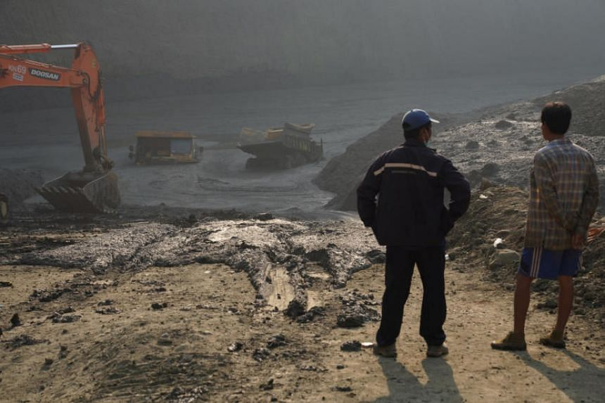 """Local police described a freak accident in Kachin state so big it created a huge """"mud lake"""" that buried the miners as well as some 40 vehicles."""