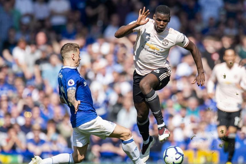 Everton's Lucas Digne (left) in action with Manchester United's Paul Pogba during the English Premier League soccer match between Everton and Manchester United held at Goodison Park in Liverpool, Britain, on April 21, 2019.