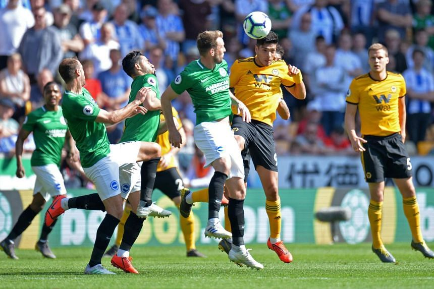 Brighton's Dale Stephens in action with Wolverhampton Wanderers' Raul Jimenez at Molineux Stadium, Wolverhampton, Britain, on April 20, 2019.