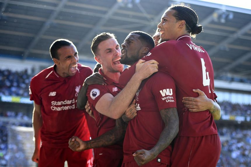 Liverpool's Georginio Wijnaldum (second from right) celebrates after scoring against Cardiff during their English Premier League game at Cardiff City Stadium, Cardiff, Britain, on April 21, 2019.