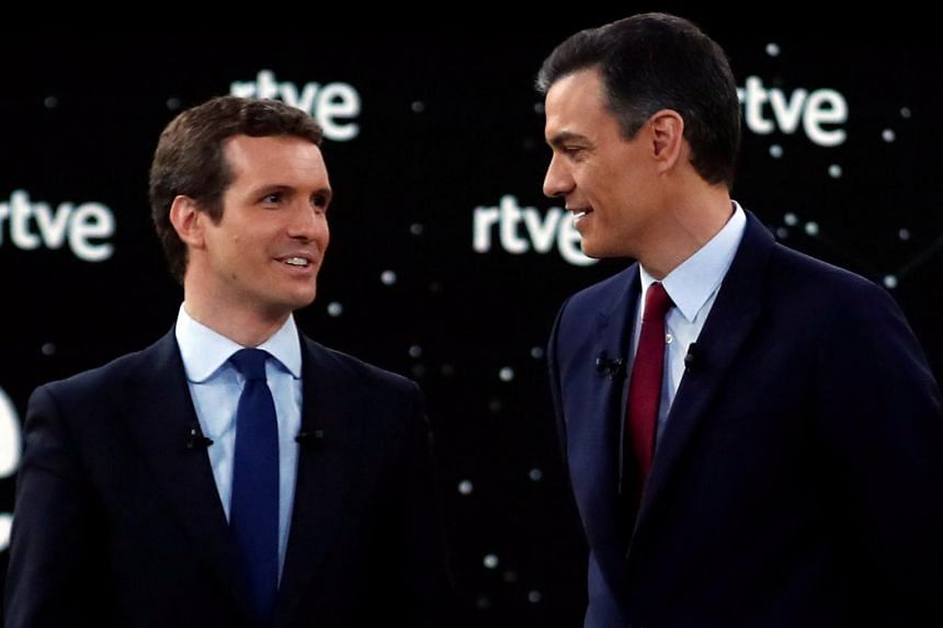 Pablo Casado of the People's Party (left) speaking to Spanish Prime Minister Pedro Sanchez of the Socialist Workers' Party during a debate, on April 22, 2019.