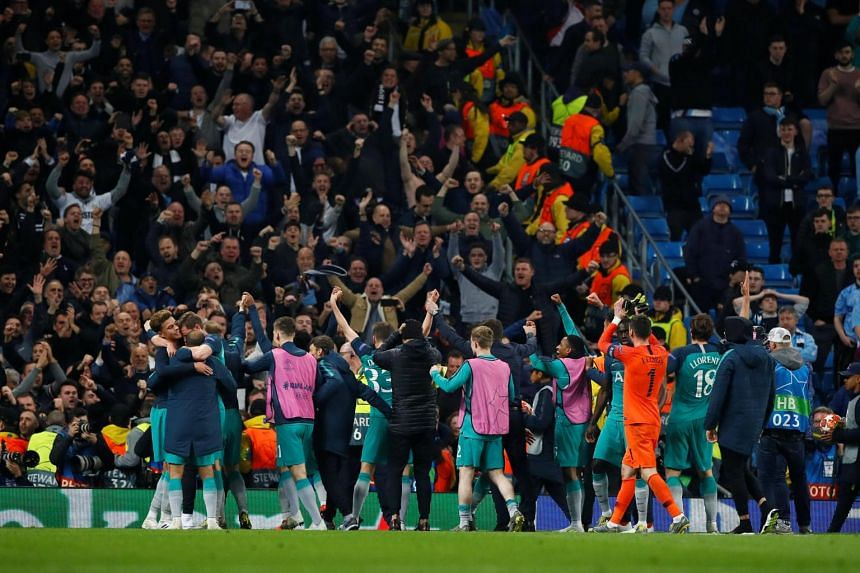 Tottenham Hotspur players celebrate after the match Action at Etihad Stadium, Manchester, Britain, on April 17, 2019.