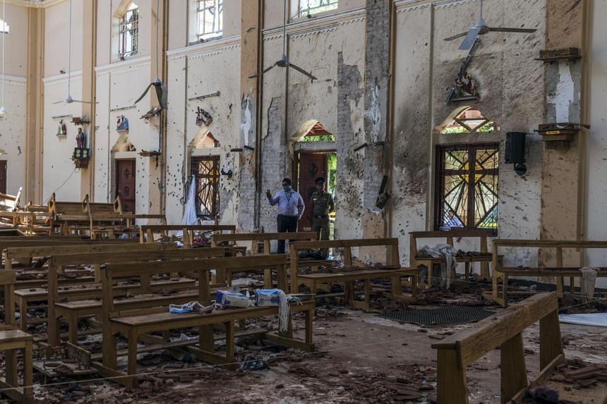 Investigators at the scene of a suicide bombing at St Sebastian Church in Negombo, Sri Lanka, on April 22, 2019.
