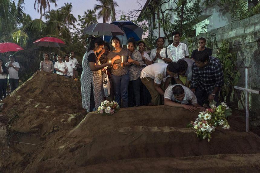Mourners grieve in Negombo, Sri Lanka, on April 22, 2019.
