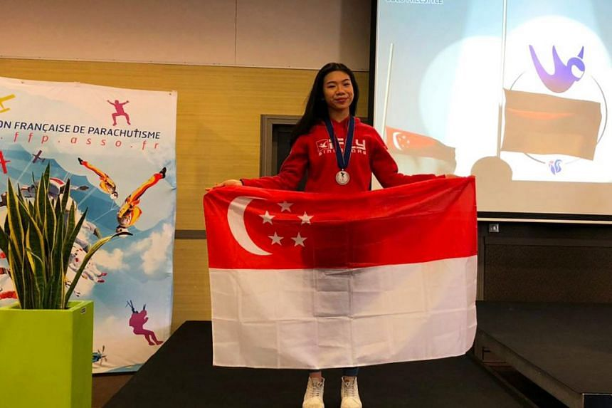 A proud Kyra Poh, 16, with her silver medal at the championships in Lille, France.