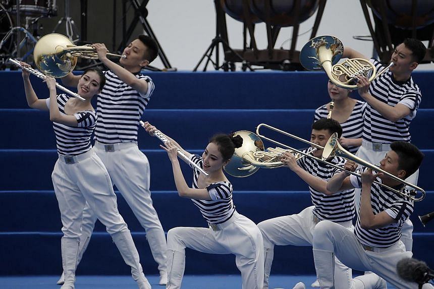 China's People's Liberation Army (PLA) Navy military band performing at the 70th anniversary celebration of the navy in Qingdao on Monday.