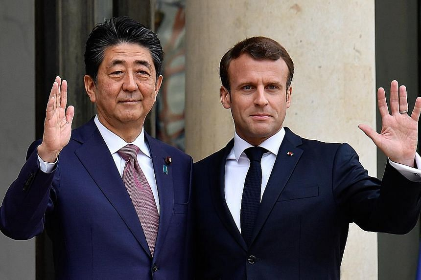 Japanese Prime Minister Shinzo Abe and French President Emmanuel Macron at the Elysee Palace in Paris yesterday.