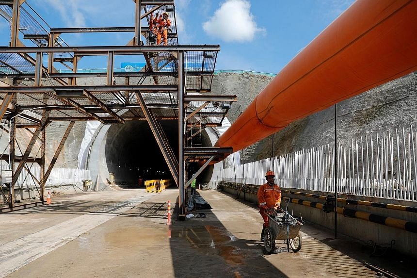 Employees working on the Wallini tunnel construction site for the Jakarta-Bandung High Speed Railway in West Bandung, West Java.