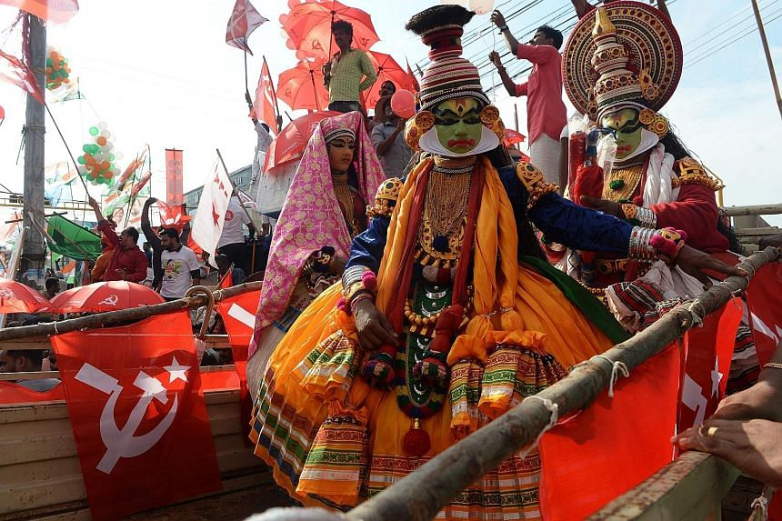 Indian Kathakali artists taking part in a rally with supporters of the Communist Party of India (Marxist) on Sunday, the final day of election campaigning in Pathanamthitta district in the south Indian state of Kerala.