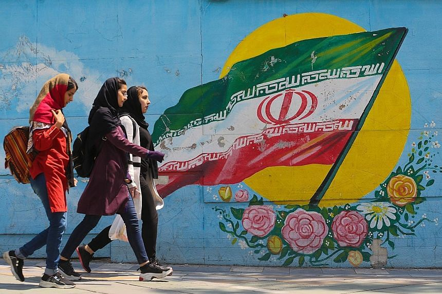 A mural showing the Iranian flag in Teheran yesterday. On Monday, the White House said it would end the six-month sanction waiver for all buyers of Iranian crude from May 1.