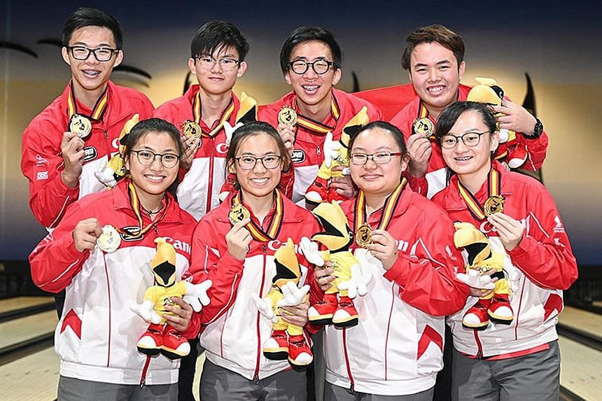 Doing Singapore proud at the 20th Asian Youth Tenpin Bowling Championships in Kuching, Sarawak are back (from left): Brandon Ong, Eugene Yeo, Jomond Chia and Xavier Teo; and front (from left): Jermaine Seah, Charlene Lim, Charmaine Chang and Amabel C