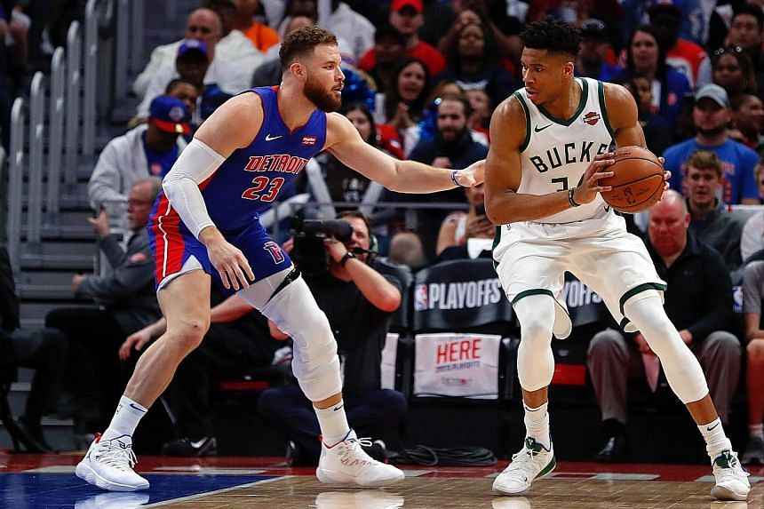 Detroit Pistons' Blake Griffin marking Milwaukee Bucks star Giannis Antetokounmpo in Game 4 of their NBA play-offs first-round series at Little Caesars Arena on Monday. The Bucks won 127-104 to complete a 4-0 sweep.