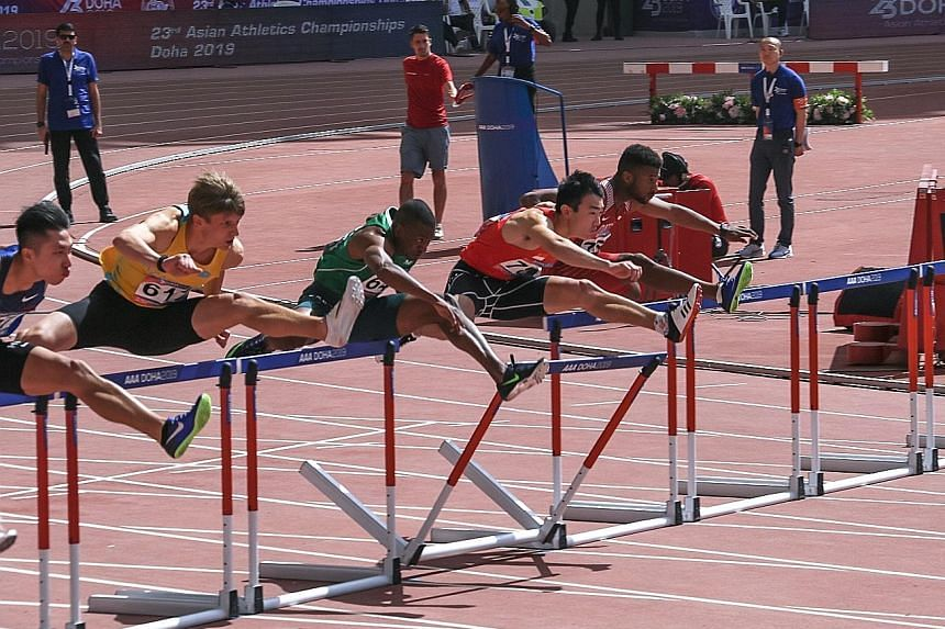 Ang Chen Xiang (second from right) hit the first hurdle hard during his 110m hurdles race at the Asian Athletics Championships in Doha yesterday but still set a national record of 14.25 seconds.
