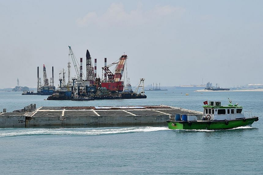 The final caisson (centre) at the first phase of the Tuas mega-port. The first phase will be fully operational in 2027 and cost $2.42 billion. The completed port is set to be the world's largest single-container terminal.