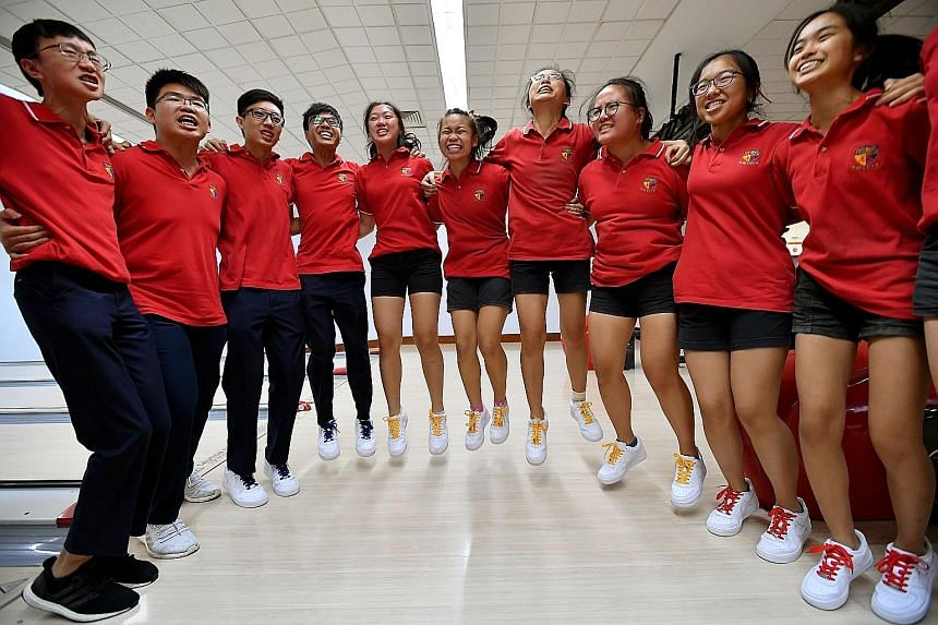 Anglo-Chinese Junior College students cheering at the end of the Schools National A Division bowling finals at Orchid Bowl yesterday. The girls' team overcame a huge deficit against Raffles Institution to retain their quartet title. The ACJC boys wer