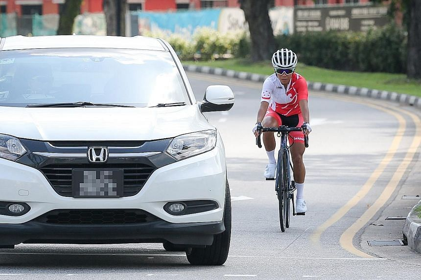 Chelsie Tan stresses that one should cycle as close to the kerb as possible, in case drivers make a left turn without signalling. ST PHOTO: ONG WEE JIN